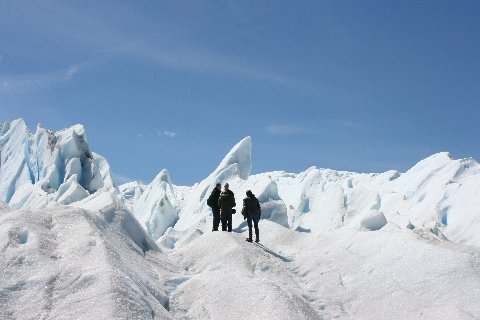 A walk on the Perito Moreno glacier with seracs in the background.