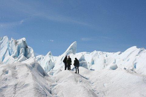 A walk on the Perito Moreno glacier with seracs in the background.