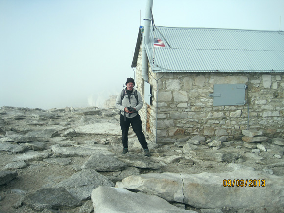 In front of the old (1909) atone cabin on the summit.