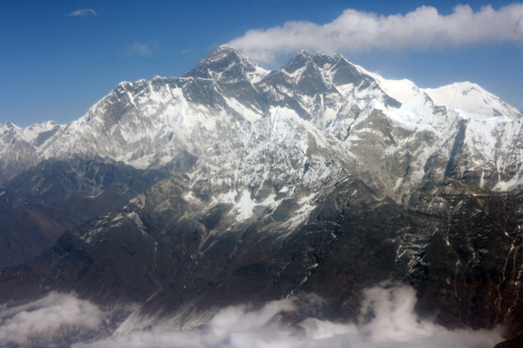 Mt. Everest with its familiar plume of blowing snow.
